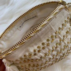 Anthropologie cream and gold makeup bag. Nwot
